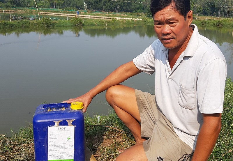 A shrimp farmer beside his bio-product.