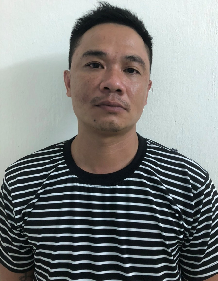 Đối tượng Nguyễn Quốc Thái tại cơ quan điều tra. Ảnh: Công an cung cấp