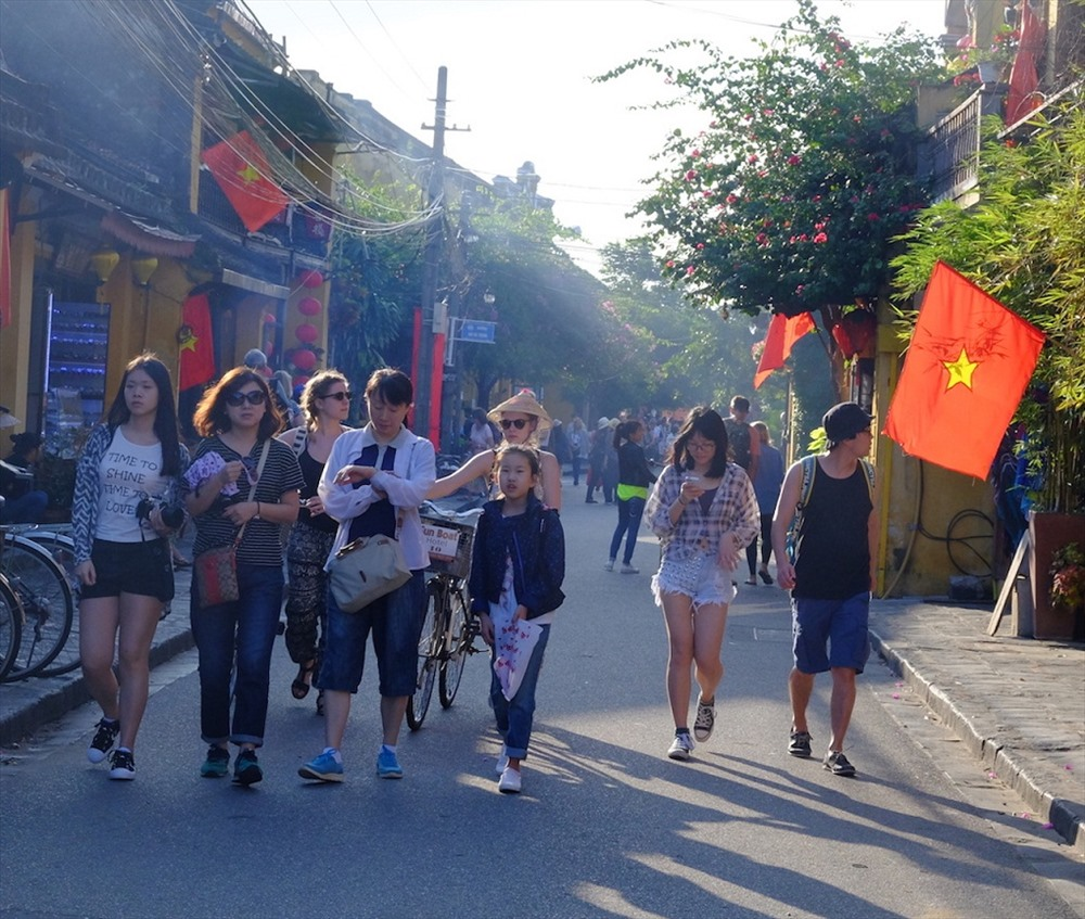 Visitors to Hoi An ancient town