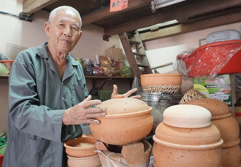 Mr. Biet and his wife's pottery stand