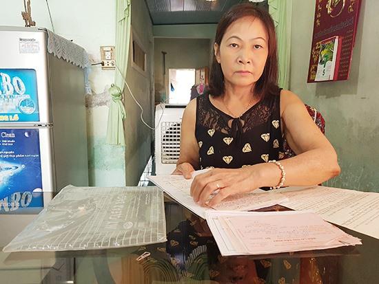 Bà Cúc mong muốn cấp chính quyền cấp sổ đỏ cho phần đất và căn nhà ở của bà nằm trong phần đất đã cấp giấy chứng nhận cho anh trai mình. Ảnh: T.C