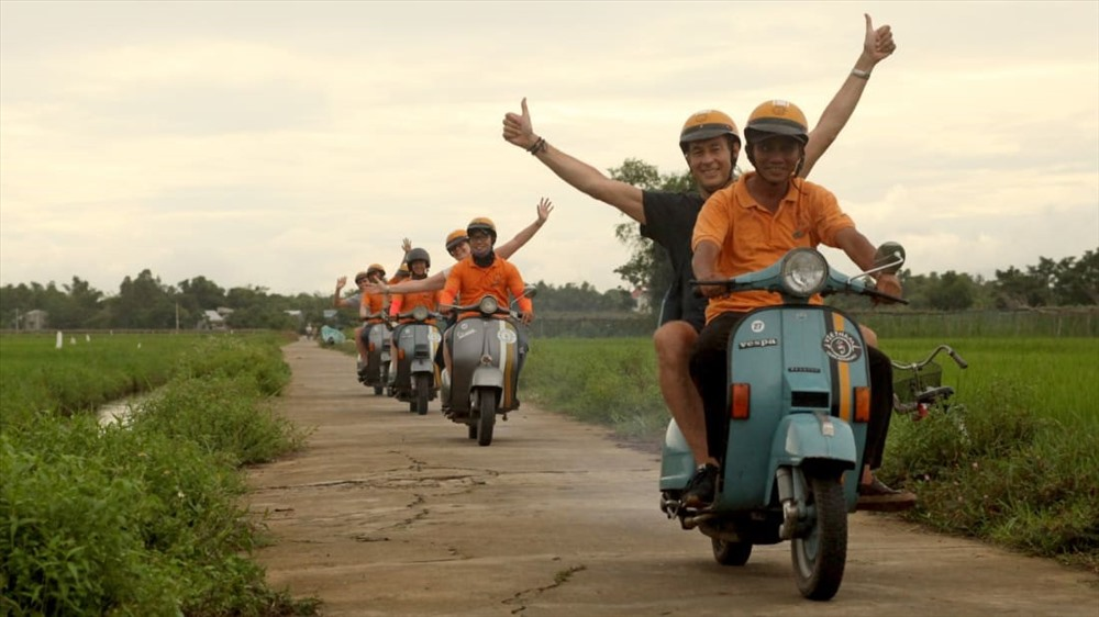 Exploring Hoi An by a classic Italian scooter (Photo: CNN)