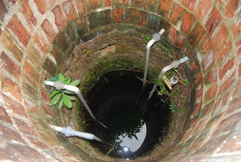Giếng Chăm ở vườn nhà ông Võ Đợi (xã Tam An, Phú Ninh). Ảnh: HOÀNG MINH