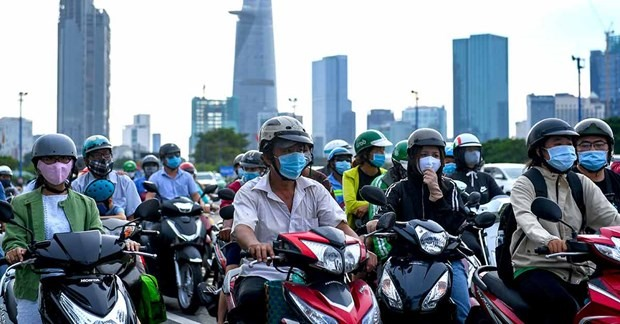 Motorists wait on their motorcycles at a traffic light during rush hour in Ho Chi Minh City on September 8, 2020. (Photo: AFP)