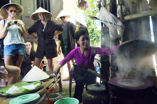 Foreign tourists at a traditional craft village in Quang Nam