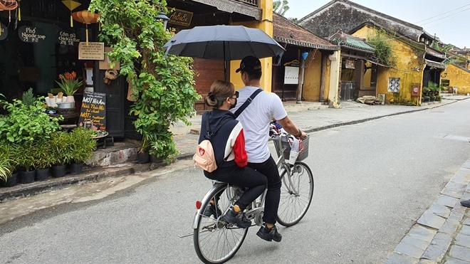 More and more young people go to Hoi An.