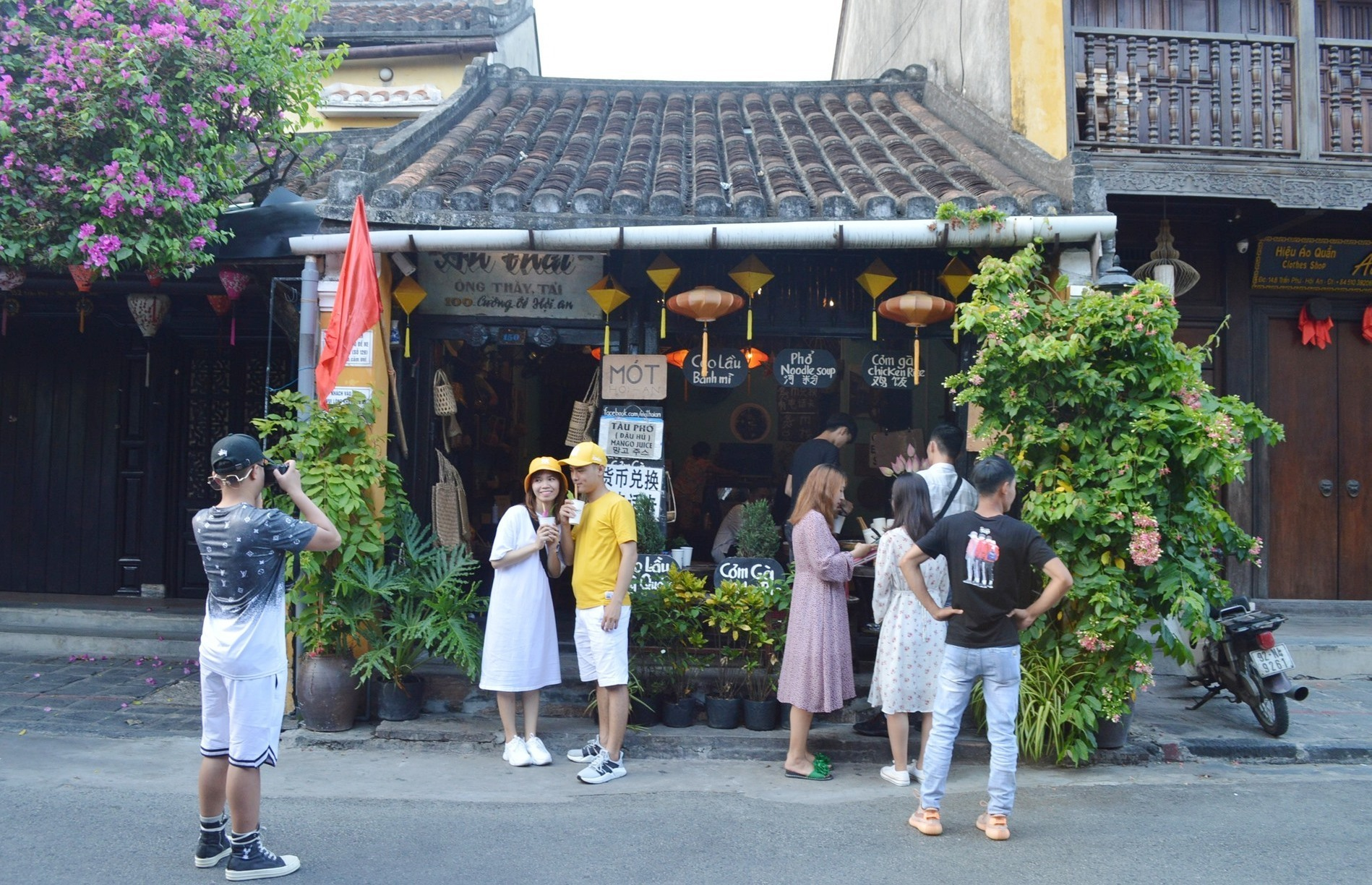 Foreign tourists in a fashion shop in Hoi An