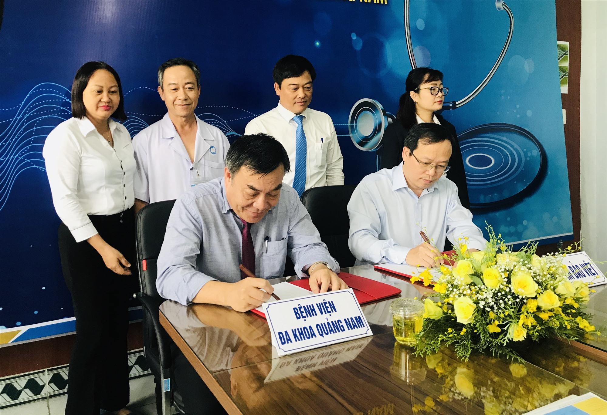 Tổng Công ty Bảo hiểm Bảo Việt và Bệnh viện Đa khoa Quảng Nam ký kết hợp tác bảo lãnh viện phí. Ảnh: C.N