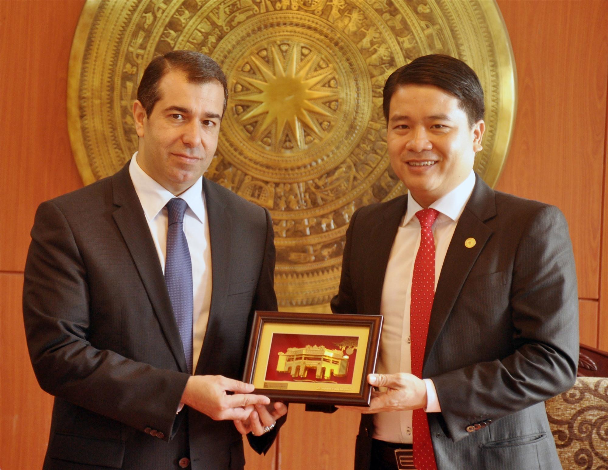 Vice Chairman Tan (R) and Azerbaijani Ambassador Anar Imanov