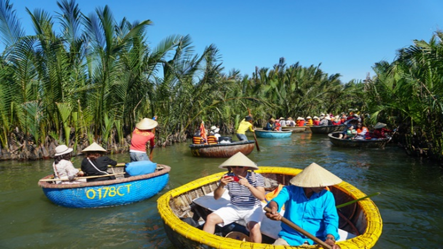 Visitors on coracles in Bay Mau nipa forest