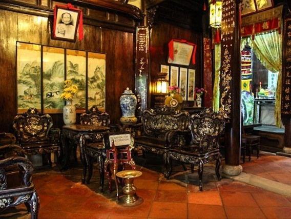 Wooden nacred table and chairs in Tan Ky ancient house. Photo: vanhien.vn
