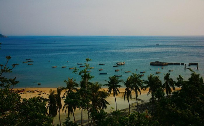 Small boats on the peaceful sea water at Huong beach
