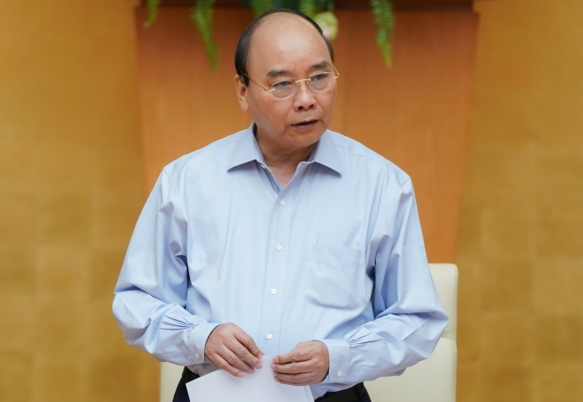 Thủ tướng Nguyễn Xuân Phúc phát biểu tại cuộc họp - Ảnh: VGP/Quang Hiếu