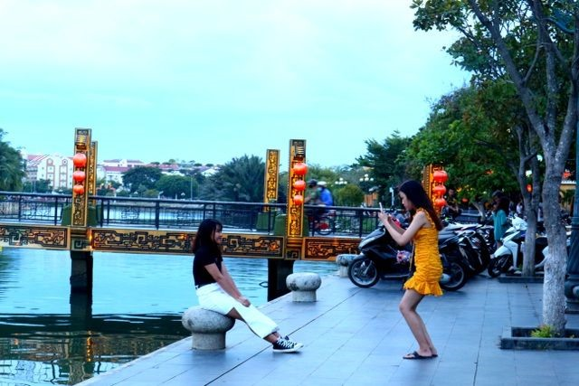 Taking photos at an attractive site in Hoi An