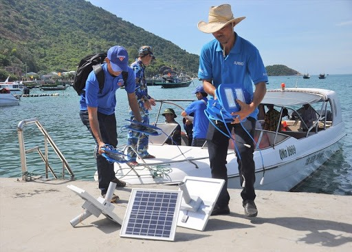 Pham Phu Hien (right) and solar lamps on Cham Islands