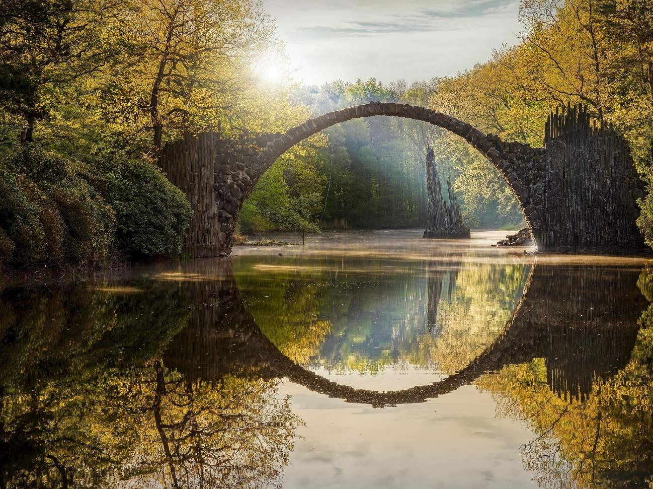The bridge is in Dahu park, Taipei, Taiwan. It is very charming, especially at moon nights.