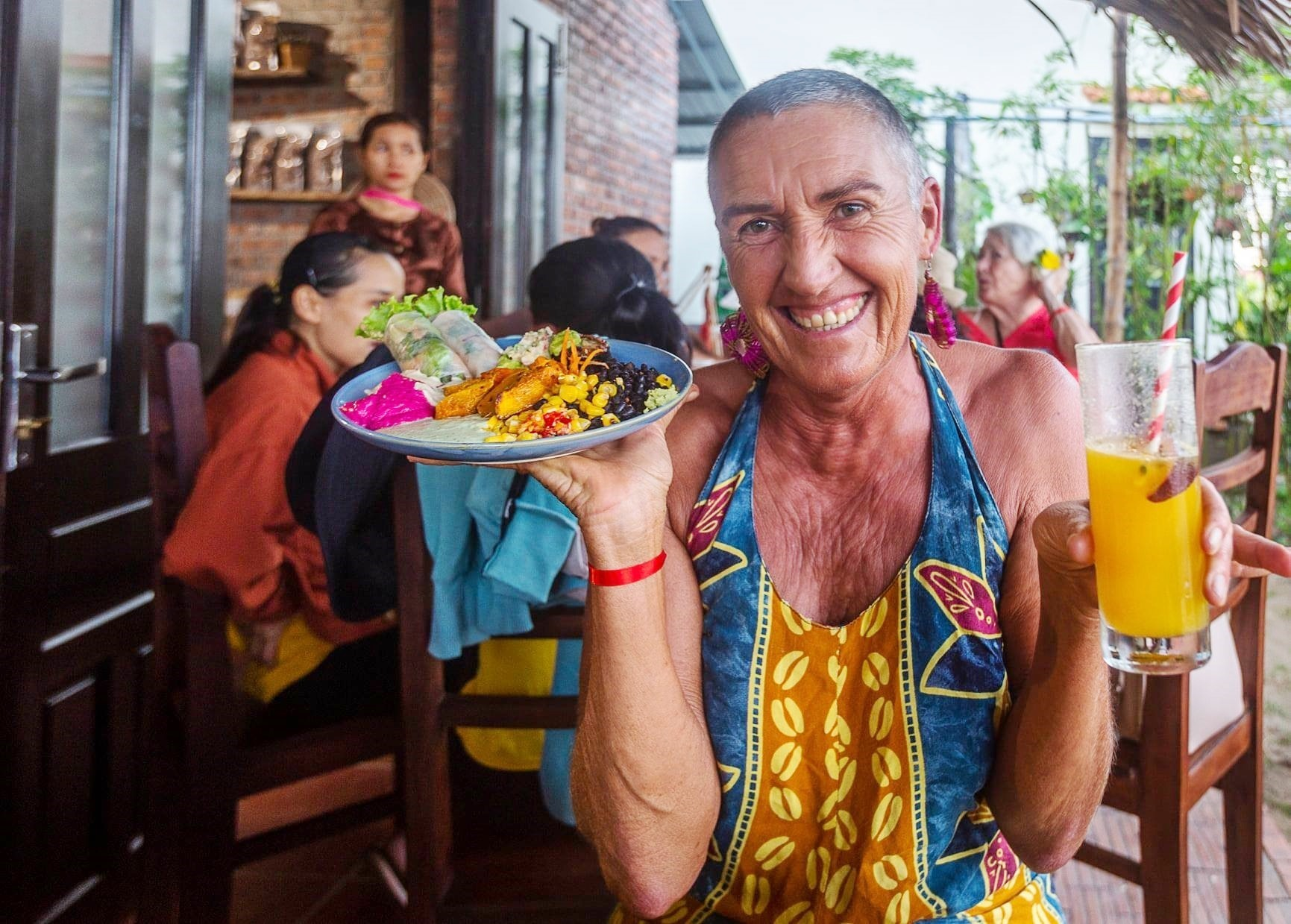 Foreign tourists enjoy vegetarian food at Veggie Hut restaurant