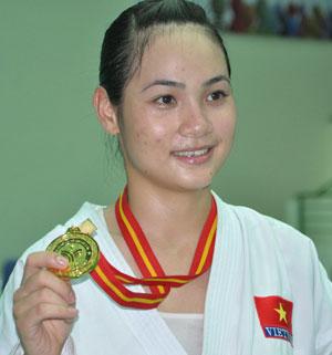 Bùi Thị Triều từng đoạt 2 huy chương vàng SEA Games nhưng chưa được hưởng chế độ ưu  đãi nào của tỉnh.Ảnh: A.S