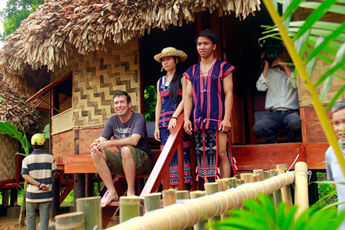Many tourists enjoyed and  took part in the unique cultural activities  organised  by local people at the traditional Mool House. Photo: Thanh Cong