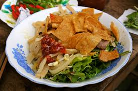 Visiting Hoi An Ancient Town, many tourist like to enjoy Cao lau specialty for their  meals