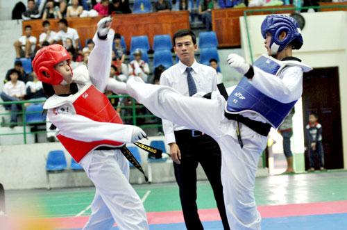Phái nữ chịu nhiều áp lực trong các môn võ thuật.Ảnh: AN NHI