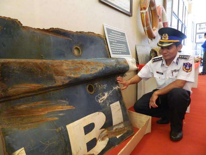 Political instructor Nguyen Quoc Huy of the Vietnamese Coast guard vessel 2016 is moved when seeing the broken pieces of his vessel which was rammed by Chinese ships in April 2014.