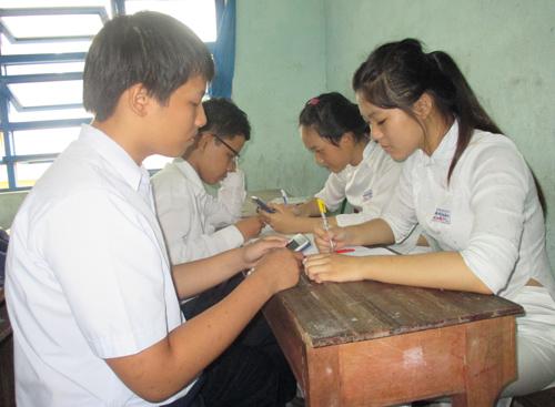 Từ năm 2015, học sinh học hết chương trình THPT chỉ phải tham gia kỳ thi quốc gia duy nhất để xét tốt nghiệp và xét tuyển sinh vào ĐH-CĐ.  Ảnh: Bùi Thị Thanh Minh