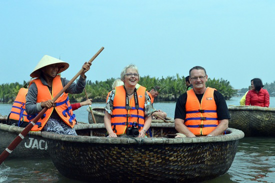 The tourists visit Cam Thanh coconut forests by basket boats.