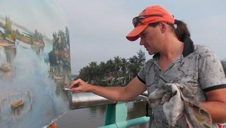 Serge Timonave is painting  De Vong river's landscape.