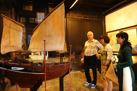 President Milan Stech learns about Quang Nam's wooden barge .