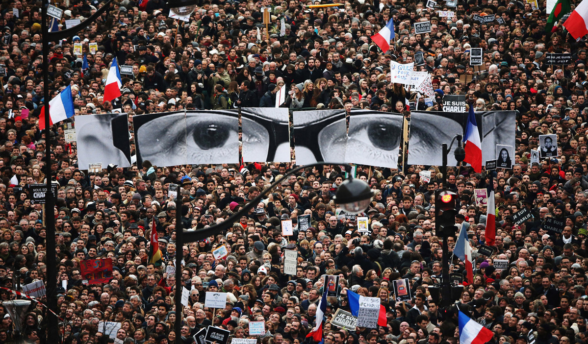 Demonstrators make their way along Boulevard Voltaire in a unity rally in Paris following the terrorist attacks on January 11, 2015 in Paris, France. An estimated one million people were expected to converge in central Paris for the Unity March in remembrance of the 17 victims of a terrorist attacks in the country. French President Francois Hollande led the march, joined by world leaders in a sign of unity. The terrorist atrocities started with the attack on the French satirical magazine Charlie Hebdo, killing 12, and ended days later with sieges at a printing company in Dammartin en Goele and a kosher supermarket in Paris with four hostages and three suspects being killed. # Christopher Furlong / Getty