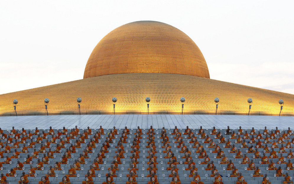 Thai Buddhist monks pray and gather at Wat Dhammakaya temple in Pathum Thani province to participate in Makha Bucha Day ceremonies on March 4, 2015. Makha Bucha, a religious holiday that marks the anniversary of Lord Buddha's mass sermon to the first 1,250 newly ordained monks 2,558 years ago. # Sakchai Lalit / AP