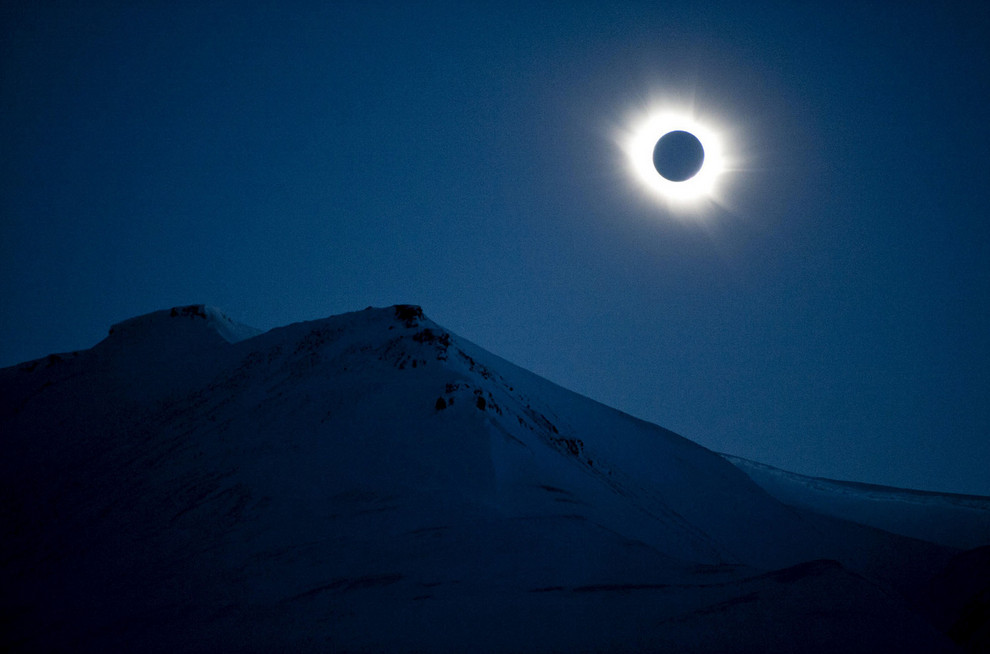 A total solar eclipse is seen in Longyearbyen on Svalbard on March 20, 2015. A partial eclipse was visible on Friday, the first day of northern spring, across parts of Africa, Europe, and Asia. The total eclipse of the sun was only visible in the Faroe Islands and the Norwegian archipelago of Svalbard in the Arctic Ocean. # Jon Olav Nesvold / NTB scanpix / Reuters