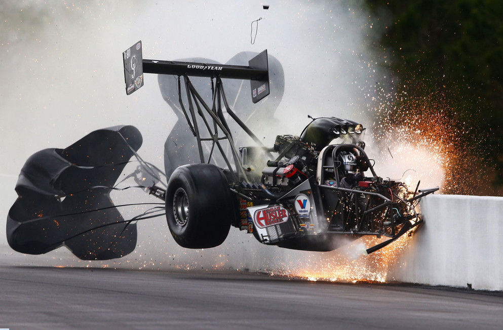 National Hot Rod Association top fuel dragster driver Larry Dixon crashes after his car broke in half during qualifying for the Gatornationals at Auto Plus Raceway on March 14, 2015, in Gainesville, Florida. Dixon walked away from the incident. # Mark J. Rebilas / USA Today Sports / Reuters