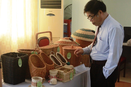 A tourist  with the products of community tourism village