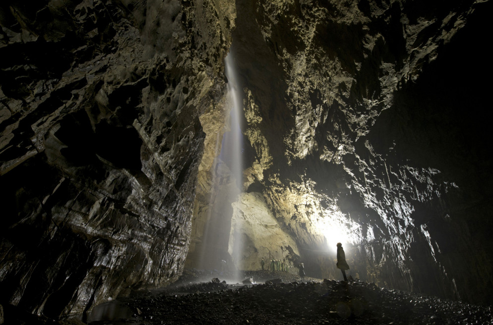 Members of the public visit the Main Chamber of Gaping Gill, the largest underground cavern in Britain naturally open to the surface, near Ingleton, England, on May 26, 2015. At a depth of almost 100 meters from the surface, and with a volume comparable to the nave of York Minister, trips into Gaping Gill cavern are offered twice a year to members of the public alternatively by Bradford Pothole Club and Craven Pothole Club. #  Oli Scarff / AFP / Getty