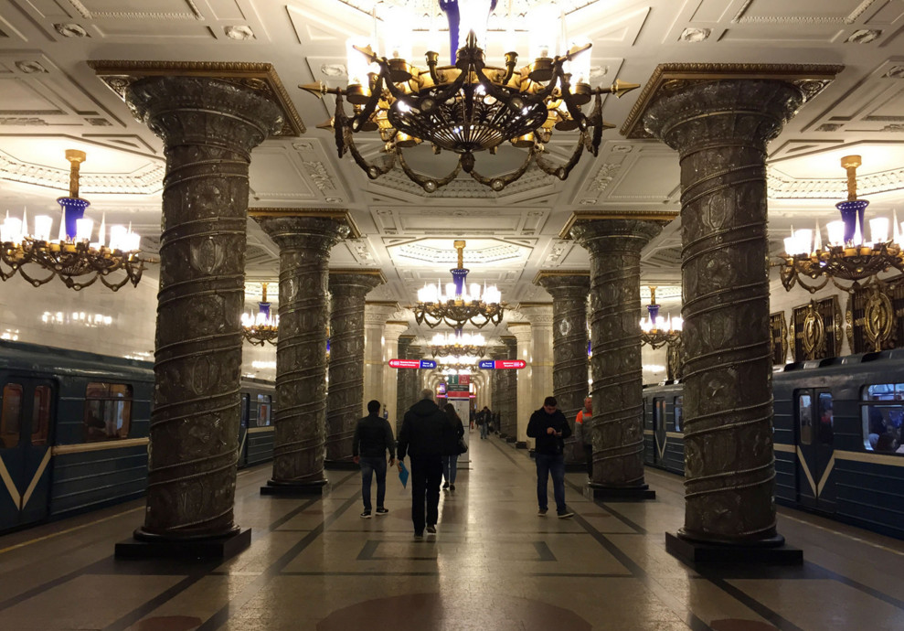 This October 13, 2015 photo shows a subway station in St. Petersburg, Russia. The station's ornate decor includes chandeliers, columns and paneled ceilings. #  Cara Anna / AP