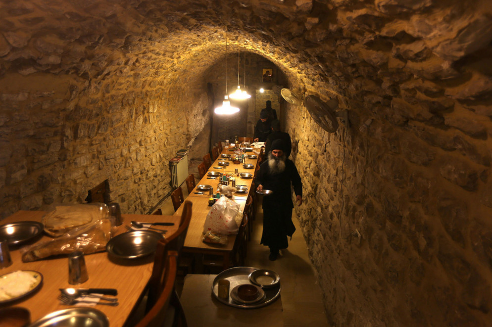 A Greek Orthodox monk prepares breakfast at Our Lady of Hamatoura Monastery in northern Lebanon on March 8, 2016. The monastery's history goes back to the fifth century. It faced destruction and persecution during the Mamluk and Ottoman eras and was restored in 1994. #  Patrick Baz / AFP / Getty