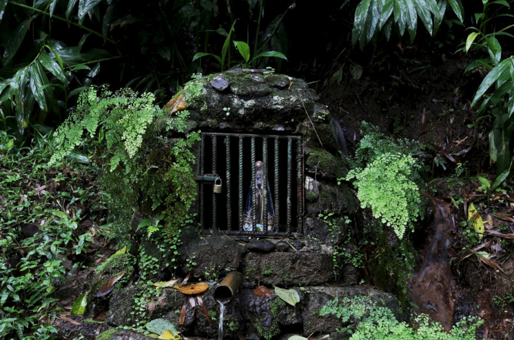 A source of water and a statue of Our Lady of Aparecida, Brazil's national saint, inside a cave in Sao Francisco Xavier, Sao Paulo, Brazil, on March 3, 2016. #  Nacho Doce / Reuters