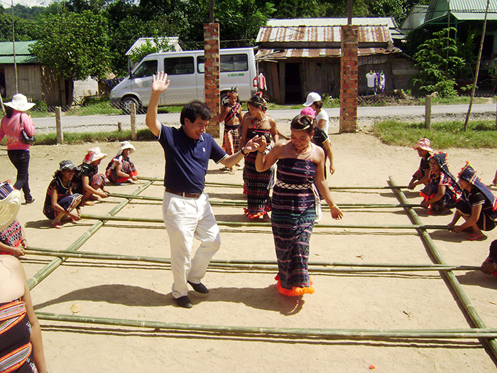 Tourists in a Co Tu traditional dance in Nam Giang district