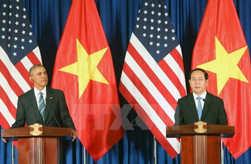 US President Barack Obama and Vietnamese counterpart Tran Dai Quang at the joint press conference following their talks on May 23