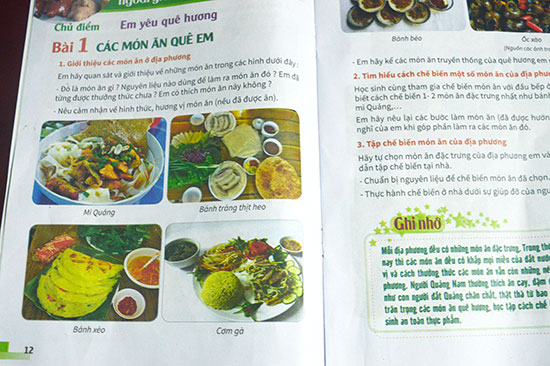 Một trang giới thiệu món ăn Quảng Nam trong tài liệu giáo dục địa phương. Ảnh: Q.TUẤN