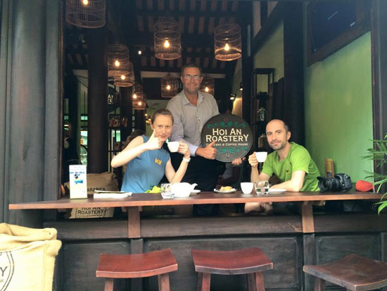 Rudy van Bork (right) and his clients in Hoi An Roastery.