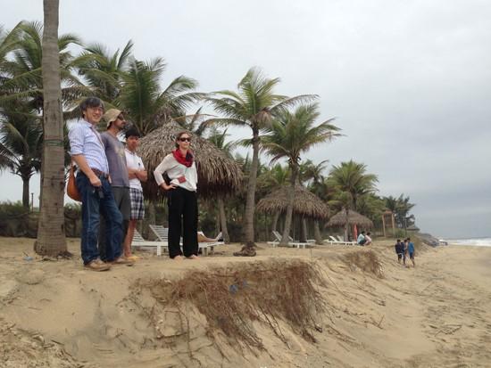 Prof. Tanaka (left) and his coworkers at Cua Dai Beach. Photo: MINH HAI