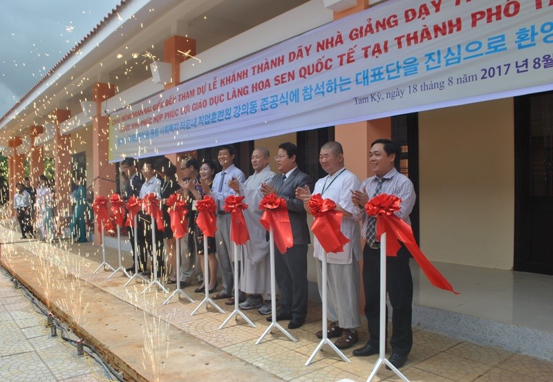 Cutting red ribbon to open school