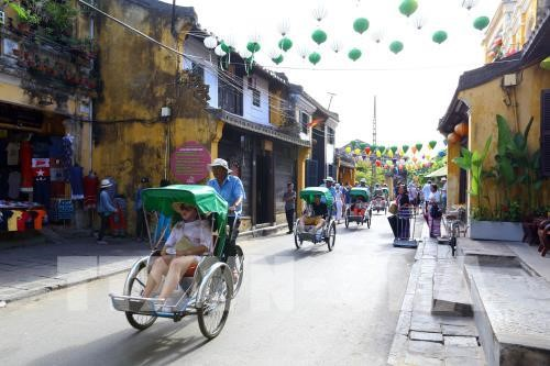 Old houses and roads always attract tourists  to visit the Hoi An ancient town. Photo: Vietnam News Agency