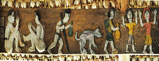 Hình ảnh con chó trong phù điêu miêu tả về lễ hội Cơ Tu. Ảnh: TẤN VỊNH