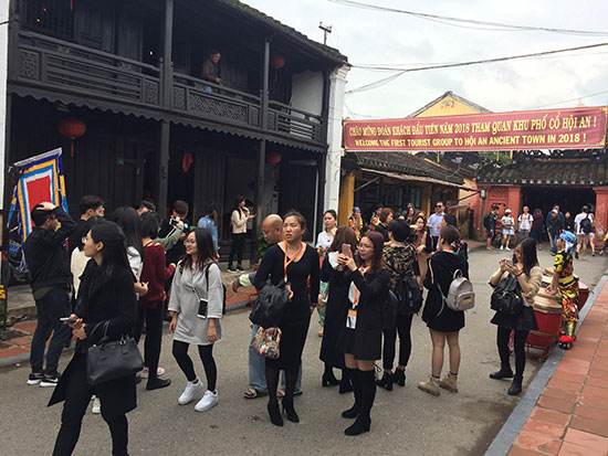 Visitors to Hoi An on the first days of the new year