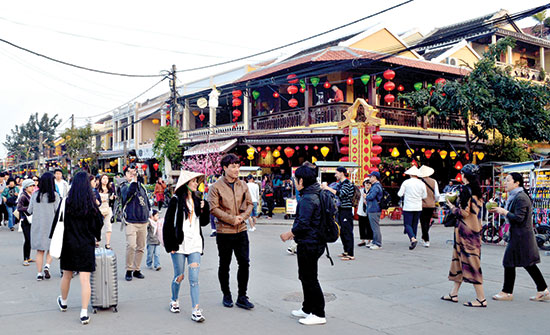 Visitors in Hoi An city.