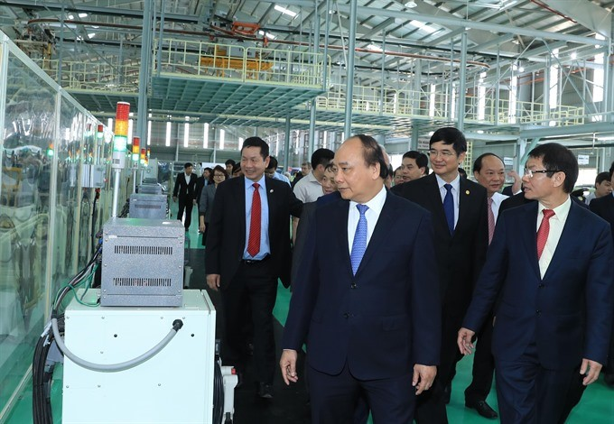 Prime Minister Phuc visits Thaco Mazda automobile manufacturing plant. Photo: VNA/VNS